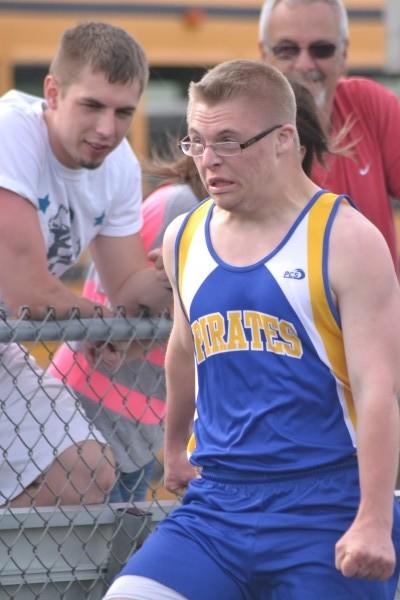 Brandon Schmidt runs past his brother Damon in the 100 meter dash.